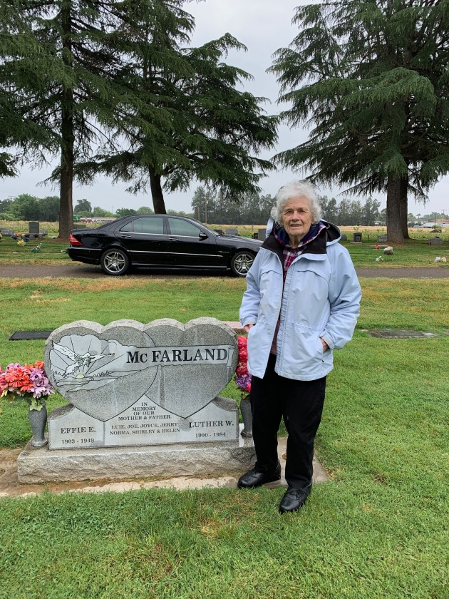 Mom at Grandpa and Grandma's headstone